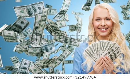 business, money, finance, people and banking concept - smiling businesswoman with dollar cash money over blue background - stock photo