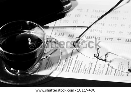 Business morning with coffee, glasses and report - stock photo