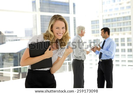 Business negotiation between two mature businessmen in the background and ecstatic assistant on foreground