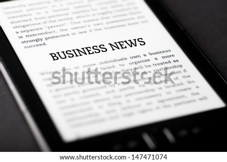 Business news on tablet pc touchpad, ebook concept - stock photo