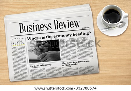 Business Newspaper with a Cup of Coffee. - stock photo