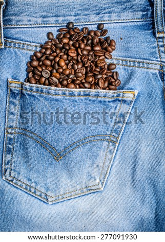 Business of coffee shop with background and texture of coffee beans in jeans pocket - stock photo