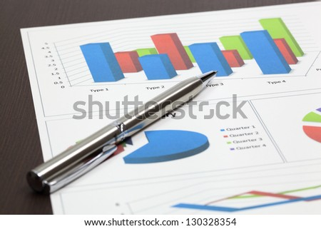 Business of financial analytics on wood table