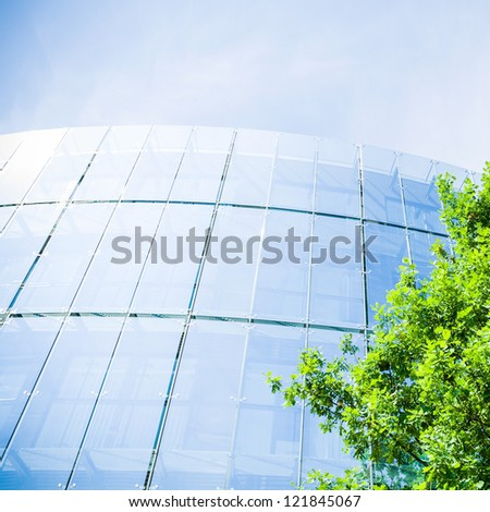 Business office building and green oak, business and nature concept