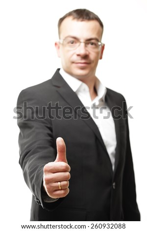 business office concept - businessman showing thumbs up in office  - stock photo