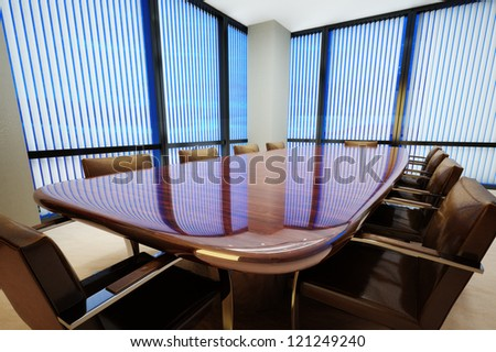 Business office conference room with table and leather chairs - stock photo
