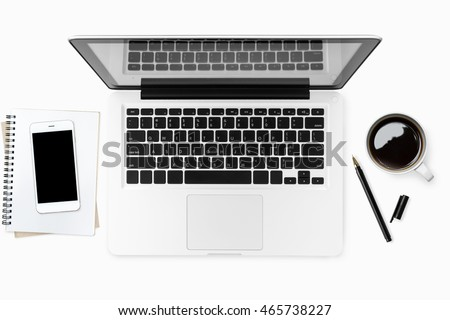 Business office desk table with laptop, coffee cup, smartphone and supplies. Top view, flat lay.