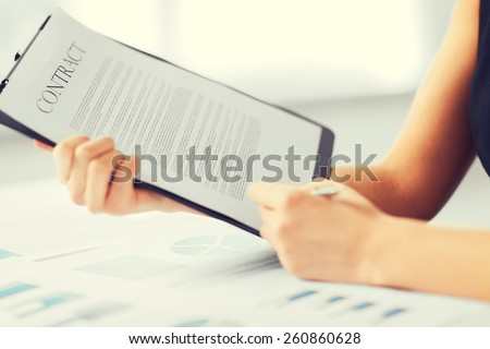 business, office, law and legal concept - picture of woman hand signing contract paper - stock photo