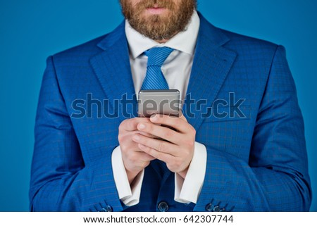business office man or young businessman with mobile phone on blue background