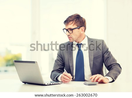 business, office, school and education concept - businessman with laptop computer, papers and calculator - stock photo