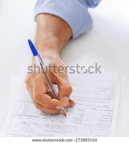 business, office, school and education concept - man filling tax form - stock photo