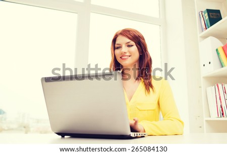 business, office, school and education concept - smiling businesswoman with laptop computer in office - stock photo