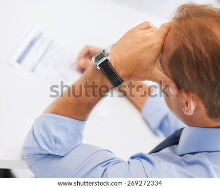 business, office, school and education concept - stressed man filling tax form - stock photo