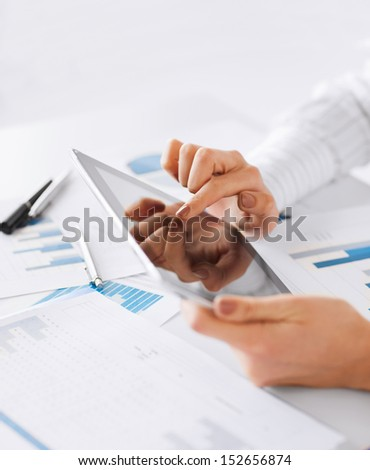 business, office, school and education concept - woman with tablet pc and chart papers - stock photo