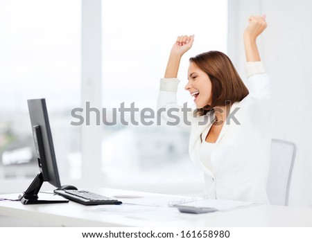 business, office, school, triumph, winning and education concept - happy businesswoman with computer in office