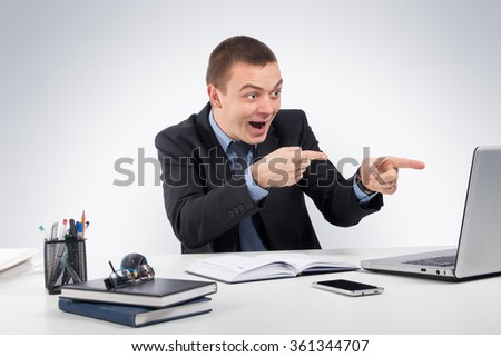 Business,office,technology, finances and internet concept - smiling businessman with laptop computer and documents at office