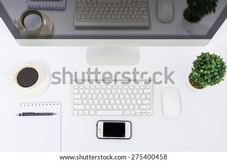 Business office top view computer monitor on white table - stock photo