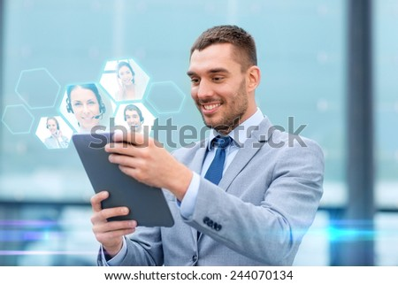 business, online communication, technology and people concept - smiling businessman making video call with tablet pc computer on city street - stock photo