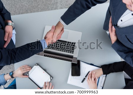 Business Partner Shake Hands on meetinig in modern office building top view
