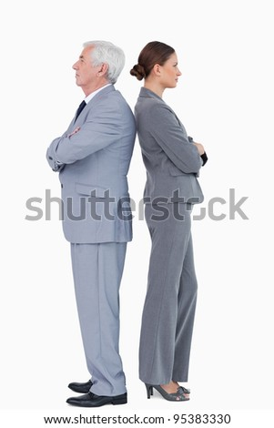 Business partner standing back to back against a white background - stock photo