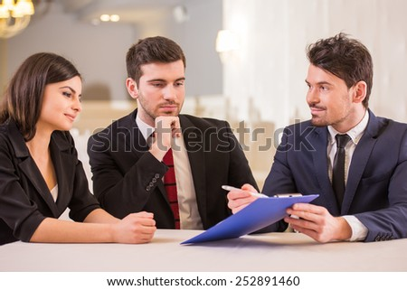 Business partners are meeting in restaurant to discuss plan of work. - stock photo