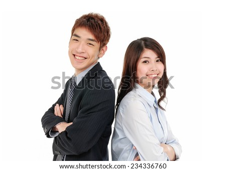 Business partners back-to-back with smiles  - stock photo