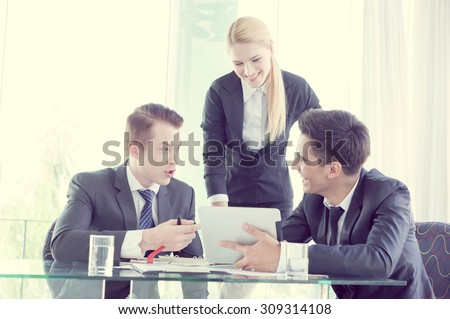 business partners discussing documents and ideas at meeting