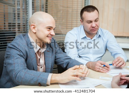 Business partners discussing ideas at meeting in workplace - stock photo