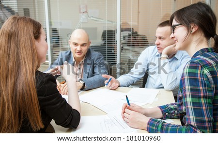 Business partners discussing ideas at meeting indoors - stock photo