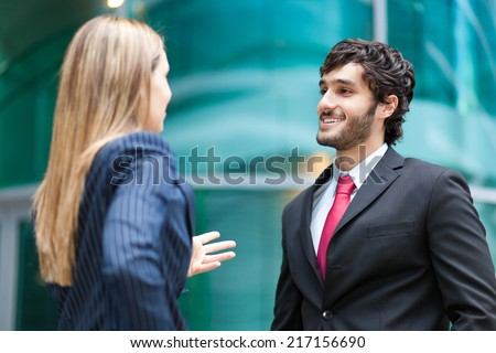 Business partners discussing together - stock photo