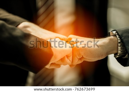 Business partners giving fist bump greeting stock photo royalty business partners giving fist bump to greeting start up new project or complete mission successful deal m4hsunfo