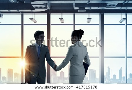 Business partners handshake