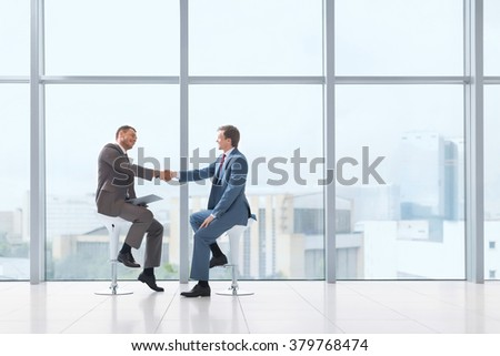 Business partners handshake in office
