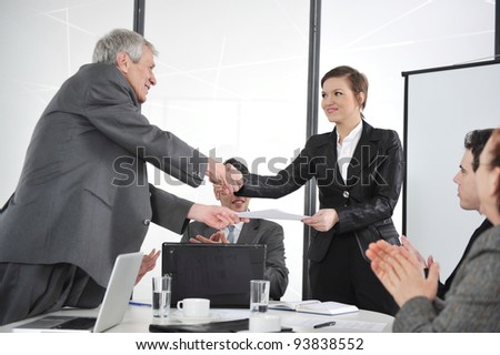 Business partners handshaking at meeting and receiving applause - stock photo