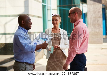 Business partners having meeting in urban environment