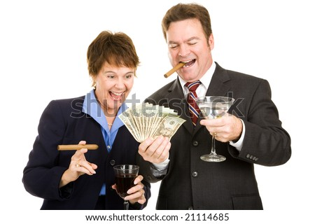 Business partners holding a wad of cash while smoking cigars and drinking cocktails.  Isolated. - stock photo