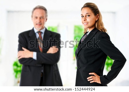 Business partners in a bright office hall