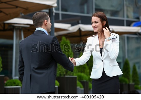 Business partners meet on the street - stock photo