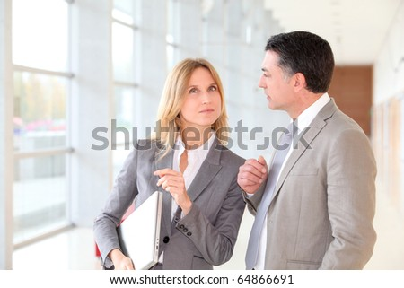 Business partners meeting in modern building - stock photo