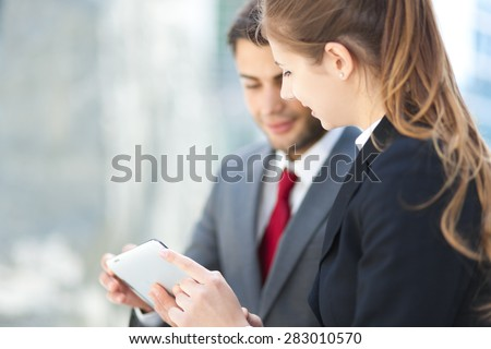 Business partners outdoor using a tablet