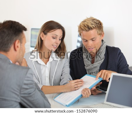 Business partners presenting business plan to investor