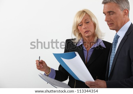 Business partners reviewing contract - stock photo