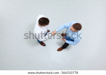 Business partners shaking hands - stock photo