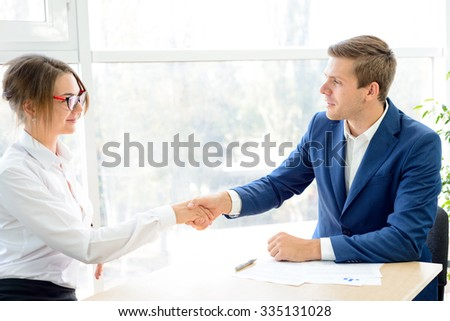 Business Partners Shaking Hands after Signing the Contract. Business Partnership Concept - stock photo