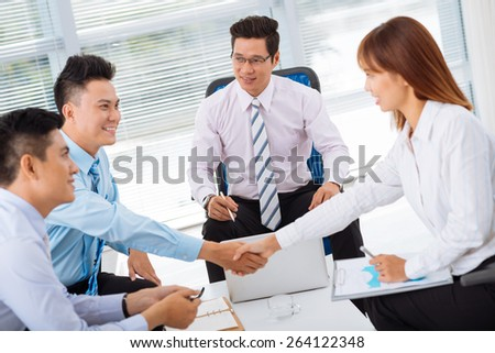 Business partners shaking hands before the meeting - stock photo