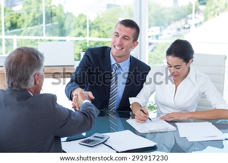 Business partners shaking hands in the office - stock photo