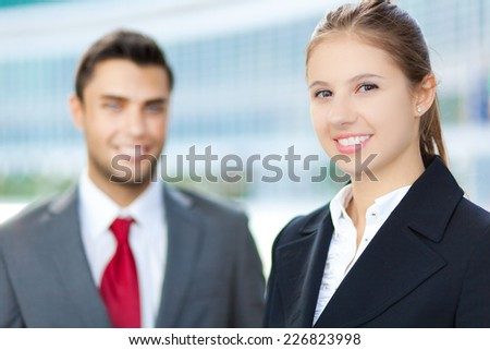Business partners smiling in an urban setting - stock photo