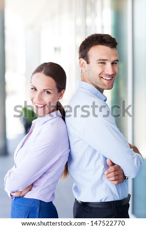 Business partners standing back to back  - stock photo