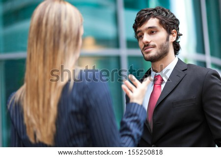 Business partners talking in an urban setting  - stock photo