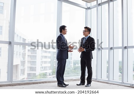 Business partners talking inside the building under construction - stock photo